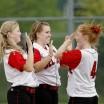 softball-girls-team-mates-happy-163465